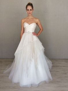 Peony / Ivory flounced silk organza and tulle A-line bridal gown. Strapless sweetheart neckline with a draped bodice and jeweled trim at the natural waist.