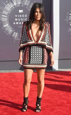 Kim Kardashian looks flawless in a cleavage-baring printed mini dress.