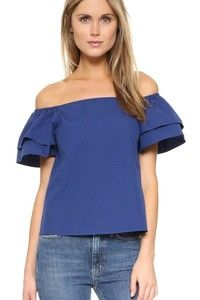 Layered ruffles form the short, full sleeves on this off-shoulder alice   olivia top. Square neckline. Fabric: Poplin. 100% cotton. Dry clean. Imported, China. Measurements Length: 21.25in / 54cm, from shoulder Measurements from size S
