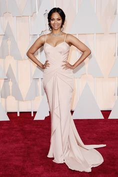 Actress Zoe Saldana was more than stunning in a custom-made #AtelierVersace blush gown draped at the waist, with full train. #VersaceCelebrities #Versace #Oscars2015