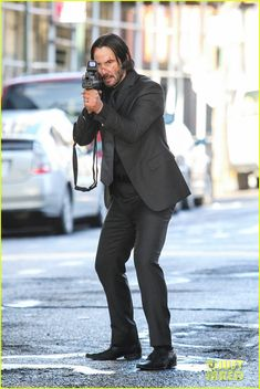 keanu reeves films action scenes for john wick 01 Keanu Reeves stands in position holding a gun while filming an action sequence for his upcoming film John Wick on Wednesday (December 18) in Brooklyn, New York.…