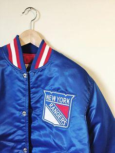 7417acf49 Vintage 1990s New York Rangers Satin Jacket   Starter  nhl  newyorkrangers   hockey