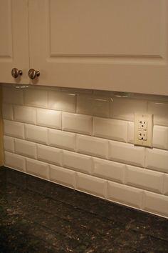 Verde butterfly granite & white beveled subway tile