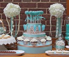 This Tiffany blue and brown dessert table, decorated with a damask print and white hydrangeas, features cake balls, cupcakes and a plethora of cookies.