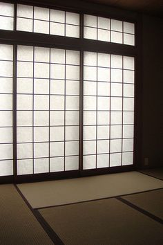 Japanese tatami room -- I never remember that a room CAN be divided in simplicity with the paper wall / sliding door ---