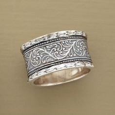 "VINCA RING -- Within textured borders, hand cast vines creep and crawl around our exclusive, sterling silver ring. Whole sizes 6 to 10. 1/2""W."