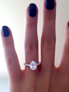 Pear shaped diamond engagement ring in U prong petite cathedral setting