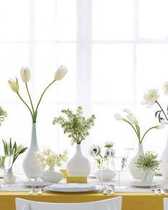 WHITE CENTERPIECE  Instead of centerpieces with oodles of blooms in them, consider spreading out petite vases filled with a few flower stems.