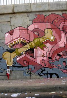 Graffiti by street artist Muro in Barcelona, Spain