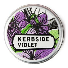 Kerbside Violet Solid Perfume: Elusive and evocative, sweet violet is captured here in its tiny glory. Kerbside Violet is inspired by chance encounters and fleeting moments: a breath of serenity allowing you to slow down and notice the tiny revolution growing through the cracks of a concrete jungle near you.