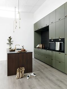 & SHUFL kitchen in fumed oak and olive linoleum.