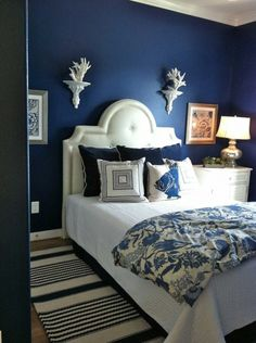 Bedroom:Sophisticated Blue Bedroom Decor For Amazing Look Dark Blue Bedroom Wall Paint Color Design Combine White Bedding Sets Plus Floral Pattern Blangket Also Antique Lamp Shade Bedroom Paint Colors, Blue Rooms, Home Bedroom, Dark Blue Walls, Navy Blue Bedrooms, Dark Blue Bedrooms, Remodel Bedroom, Blue Bedroom Design, Modern Bed Set