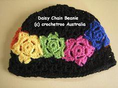 daisy chain beanie, join daisies as u go.  toddler through teen sizes.