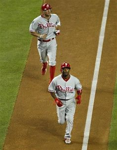 GAME 18, 4/24/12: Hunter Pence runs the bases with teammate Jimmy Rolllins on his two-run home run.