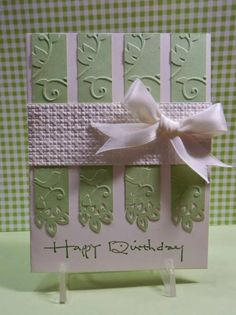By Mary (jandjccc at Splitcoaststampers). Green piece dry-embossed in Cuttlebug birds and vines embossing folder; then cut into 4 parts. Bottom edges punched with decorative border. Faux horizontal ribbon is white cardstock dry-embossed in lattice embossing folder. Bow and sentiment added. Pretty!