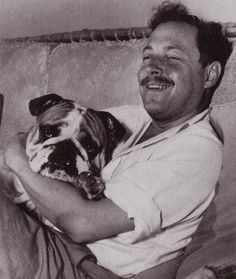 Tennessee Williams with bulldog in Key West, circa 1960.