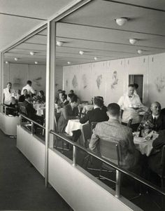 Passengers relaxing on board the zeppelin Hindenburg, May 1937.