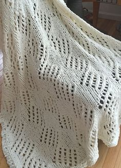 Free Knitting Pattern for Quick Angled Eyelet Blanket - An easy lace afghan that's a quick knit in super bulky yarn. Designed by Bernat for Bernat Blanket yarn -- I think it's hard to find interesting patterns for that yarn so I was happy to find this. Might make a cute baby blanket too. Pictured project by camas2012 using the recommended yarn.