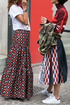 Prints are so on trend for Spring. Fashion-forward iterations like off-the-shoulder tops, ruffled hems and sleek accessories that can be worn anywhere, whether you're headed to the office or away on vacation. We love these red geometric prints. It looks so nice on a midi skirt silhouette