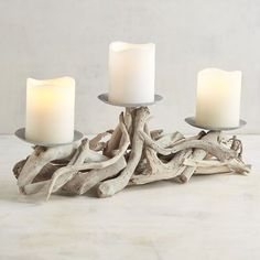 Bring the seaside tableside with the glow of your favorite pillar candles held by our naturally beautiful rustic driftwood centerpiece.