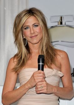 Jennifer Aniston Shoulder Length Hairstyles with Side Bangs/Getty Images