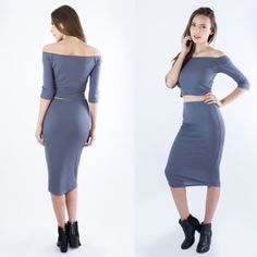 Rib Knit Crop Top & Skirt Set Rib Knit Off-Shoulder Crop Top & High-Waisted Skirt Set in Slate Grey. 3/4 Sleeves and stretchy material. NWT Retail. Flattering fit and the grey is a soft almost lilac color. Love the rib knit fabric!  1 XS Set 2 Small Sets 1 Medium Set 1 Large Set Comment size so I can make your custom listing :)  88% Tencel & 12% Spandex (cold machine wash) Made in USA Atid Clothing Skirts Midi