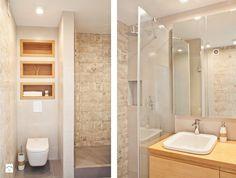 mała łazienka, prysznic, szyba oddzielająca zlew i blat.