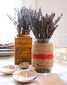 We displayed bunches of dried lavender in vintage tins and mason jars wrapped with twine. For an added touch, we painted a red stripe around the twine with regular acrylic paint.      #LavenderLover