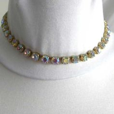 Pretty and a sparkling look with this fabulous vintage diamante necklace Single strand of clear diamante that reflect light and multi colors 1980s of age