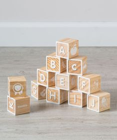 This wooden block set is a nod to the vintage wooden block toy set from days past. It looks wonderful as nursery decor but it's even more fun to stack and watch them tumble. This wooden block set is one of our best selling toys and we're sure Wooden Baby Blocks, Wooden Alphabet Blocks, Wooden Baby Toys, Wood Toys, Vintage Baby Toys, Hallmark Baby, Fall Gifts, Woodworking Toys, Kids Wood