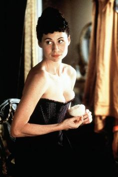 An Ideal Husband - Minnie Driver as Mabel Chiltern wearing a black textured corset.