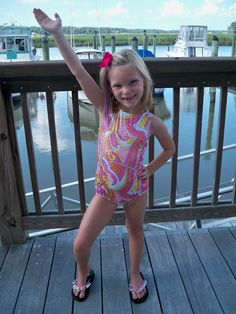 Lilly, modeling a cute pink gymnastic leotard by Body Wrappers.