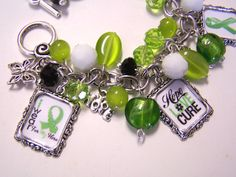 LYMPHOMA AWARENESS Themed Altered Art Charm Bracelet Handmade  **Need a duck's Unlimited awareness bracelet. Like the use of the beads.