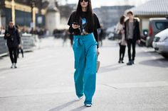 Gilda Ambrosio wearing leather Loewe pants and Loewe bag after the Elie Saab Fall /Winter 2015-2016 fashion show at the Tuileries in Paris, France