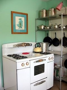 1950s kitchen. Our stove is almost exactly like this.  I like the industrial shelving, too.