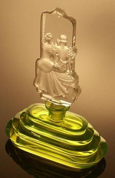 CZECH ART DECO PERFUME BOTTLES. I have a version of this bottle, but mine is a reissue, and the bottle is not green like this one. Mine is clear like the stopper. I really like this green one!