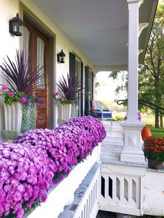 Unique urns and plantings for front porch entryTouring MacKenzie-Childs