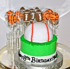 Cake pops and individual buttercream cake with edible fondant baseball for sports themed birthday party.