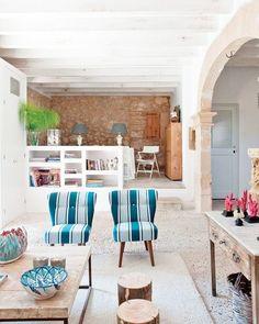 spanish stone villa living room striped chairs
