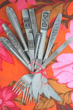 Let it Bloom! Mismatched floral flatware set - no two guests will have the same set, what you get is unique.  Visit www.oddandreloved.com to see all our available styles!