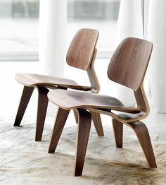 Helena chairs / Walnut. A reproduction of the Eames LCW chair. / Maison Corbeil