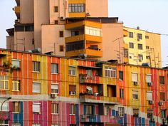 Houses in Tirana were colorful painted to get rid of the grey image of Communist times. Inside the plaster is still peeling off.