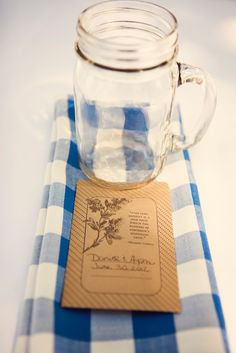 Wedding reception blue gingham napkins & mason jar drinking glasses
