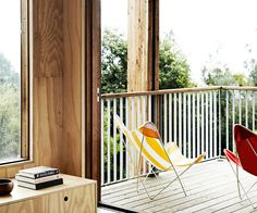 A 1970s brick holiday house gains new life – and water glimpses - via a beautiful pavilion-style timber extension.