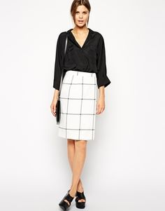 Remember last winter's check frenzy and Stella McCartney's amazing coats? Well, here's the update with a bit of a minimal twist, this nice silky textured wrap front skirt. Pair it with an oversized white shirt and red kitten heels. You are absolutely welcome!