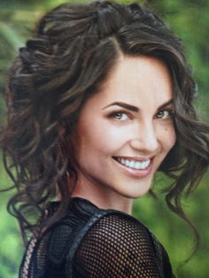 Mexican actress and model Barbara Mori. Beautiful short curly hair.