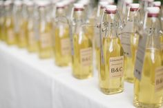 Bottles of homemade limoncello did double duty as favors and escort cards. | Love Me Do Photography