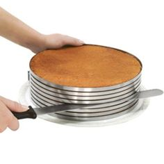 Easily create perfectly uniform multi-layered cakes with this 3 piece Frieling Stainless Steel Layer Cake Slicing Kit. This Cake Slicer Kit includes an adjustable mold, a knife and a large layer lifter. Cooking Gadgets, Cooking Tips, Cooking Ham, Kitchen Hacks, Kitchen Gadgets, Kitchen Tools, Kitchen Shop, Kitchen Helper, Kitchen Recipes