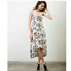 HP ON 6/21 FLORAL HIGH LOW DRESS A high low dress for all occasions! Dress it up with heels or make it more casual with sandals.   This dress is stunning either way.  True to size ~ contemporary fit.  Made in the USA!  95% rayon  5% spandex April Spirit Dresses High Low
