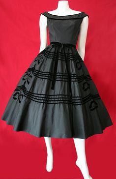 50s jet black taffeta dress with rows of black velvet trim & black velvet emblems completely edged in tiny black beads